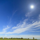 Summer landscape in the countryside with blue sky — Stock Photo