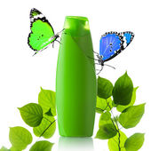 Plastic bottle and butterfly — Stock Photo