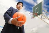 Business man with basketball — Stock Photo