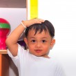Little boy measuring his height — Stock Photo