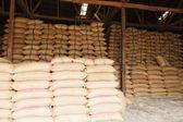Stack hemp sacks of rice — Stock Photo