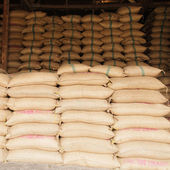 Sacks of rice in the warehouse — Photo
