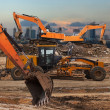Excavator and grader — Stock Photo