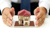 House and hands — Stock Photo
