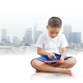 Boy using digital tablet — Stockfoto