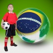 Child soccer player with Brazil ball — Stock Photo