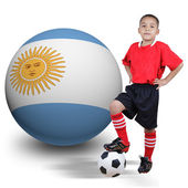 Child soccer player with Argentina ball — Stock Photo