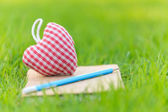 Fabric heart on diary — Stock Photo