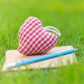 Fabric heart on diary — Stock Photo