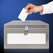 Hand with ballot and metal box — Stock Photo