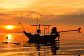 Silhouette of boat in sea — Stock Photo