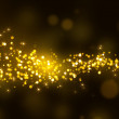 Gold glittering stars tail dust — Stock Photo #46406821