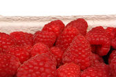 Raspberries in basket — Stock Photo