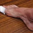 Foto Stock: Bandaged toe