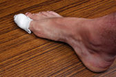 Bandaged toe — Stock Photo