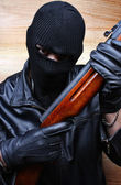 Gangster terrorist mafia criminal with a gun — Stock Photo
