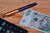 Pluma de calculadora de dinero — Foto de Stock