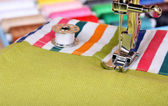 Sewing machine and item of clothing material — Stock Photo
