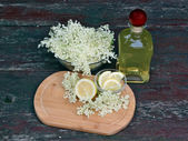 Syrup of flowers elderberry — Stock Photo