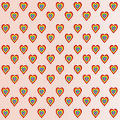 Colored hearts in light pink background — Stock Photo