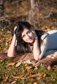 Beautiful brunette young woman outdoors — Stock Photo