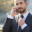 Handsome young businessman with a mobile phone  — Stock Photo