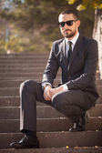 Handsome young businessman in suit outdoors — Stock Photo