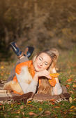 Beautiful blond woman in autumn foliage — Stock Photo