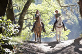 Horseback riders on the trail — Stock Photo