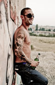 Sexy man drinking beer — Stock Photo