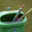 Green waste basket with used fireworks rockets — Stock Photo