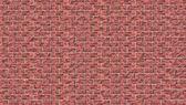 Plastic red brick wall — Stock fotografie