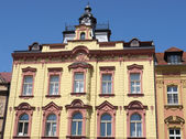 Ornamented old building with tower and clock — Foto de Stock