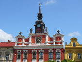 Upper part of ornamented old building with tower and clock — Foto de Stock