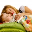 Foto Stock: Mother and son in bed