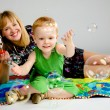 Mom and son playing with soap bubbles — Foto Stock