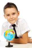 Schoolboy with a globe — Stock Photo