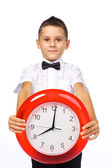 A boy and a clock — Stock Photo