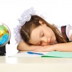 Schoolgirl Elementary School sleeping — Stock Photo