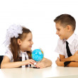 Boy and girl with globe — Stock Photo