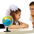Boy and girl with globe — Stock Photo #29942609