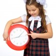 A girl and a clock — Stockfoto