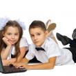 A boy, a girl and a laptop — Stock Photo