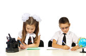 Boy and girl at the desk — Stock Photo