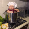 Cute chef baby in a Kitchen pot — Stock Photo