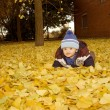 Baby on autumn leaves — Stock Photo