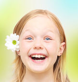 Happy little girl with flower — Stock Photo