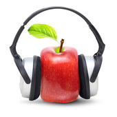 Red apple in earphones isolated — Stock Photo