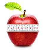Red apple with measurement isolated on white. Diet concept. — Stock Photo