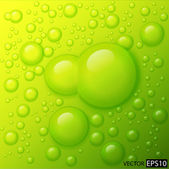 Water drops on lime green background. — Stock Photo
